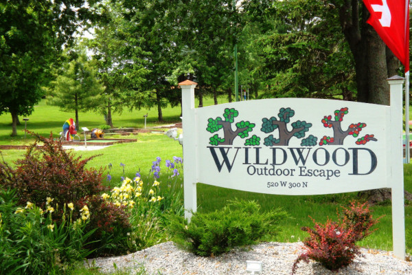 Photo of Wildwood entrance sign with flowers in bloom