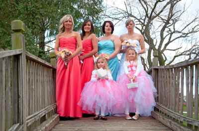 Image of wedding party posing on bridge