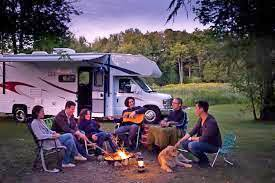 Image of campers enjoying a campfire in front of their motor home