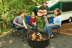Image of group of people enjoying music and a campfire